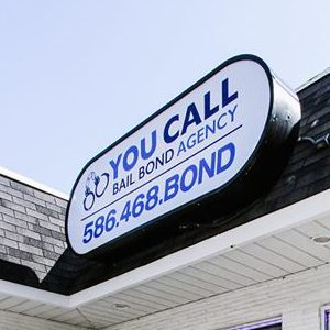 "A Sign That Says, ""You Call Bail Bond Agency 586.468.BOND"""
