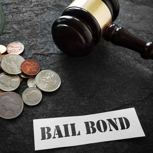 Bail Bond Process Indicated by Coins and a Gavel.