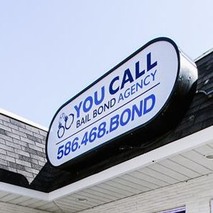 An Up Close Picture of a You Call Bail Bond Agency Sign.