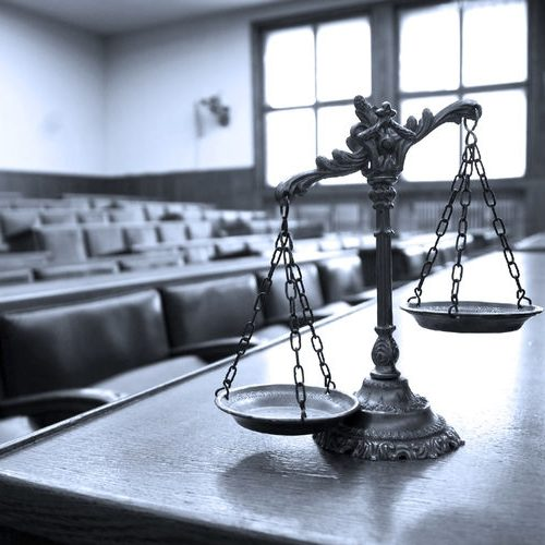 A Black and White Picture of the Symbol of Law and Justice in a Courtroom.