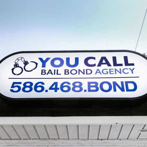 A Picture of a You Call Bail Bond Agency Business Sign.