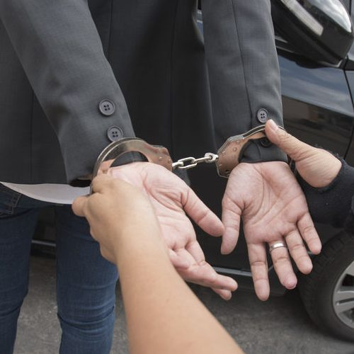 A Picture of Hands in Handcuffs.